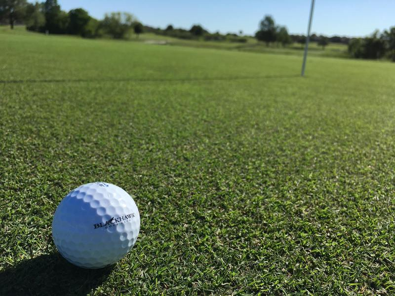 A golf ball rests on a green at Blackhawk Golf Club in Pflugerville, Texas